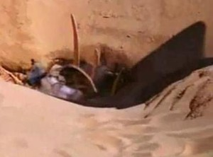 Boba Fett falling into the Sarlacc Pit in Empire Strikes Back in the desert