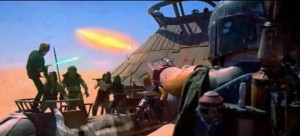 Boba Fett shooting from his wrist in Empire Strikes Back in the desert
