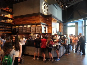 Customers assembled at the Starbucks in Downtown Disney on its first day of operation