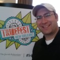 Drew Kaplan with TribeFest 2014 sign