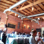 The brick walls and wooden beams give Trattoria Natalie a modern-retro look