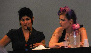 Chrissy Lynn speaking while Molly McIsaac looks on